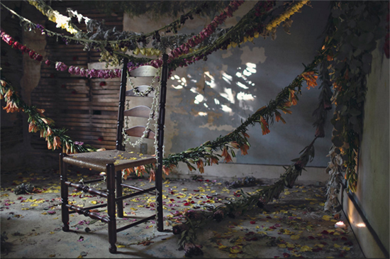 Flowers draped across old chair